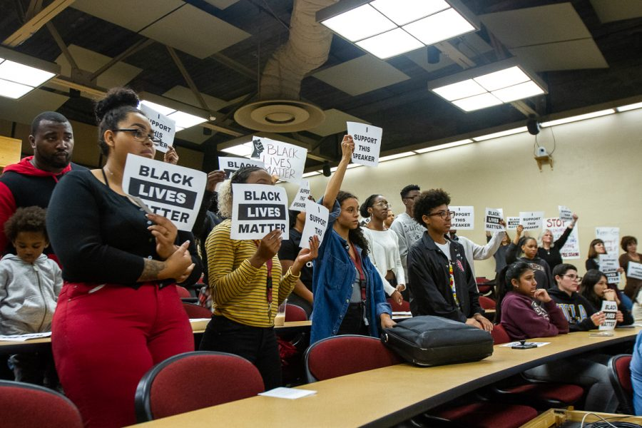"City College students and Black Student Union members hold ""Black Lives Matter"" and ""I Support This Speaker"" signs during a Board of Trustees meeting on Monday, Nov. 19, at the Administration Building at City College in Santa Barbara, Calif. They hold the signs in protest of Lyndsay Maas' use of the N-word in the Gender Equity Work Group meeting, which she said in reference to a racist comment made by a student towards a black student."