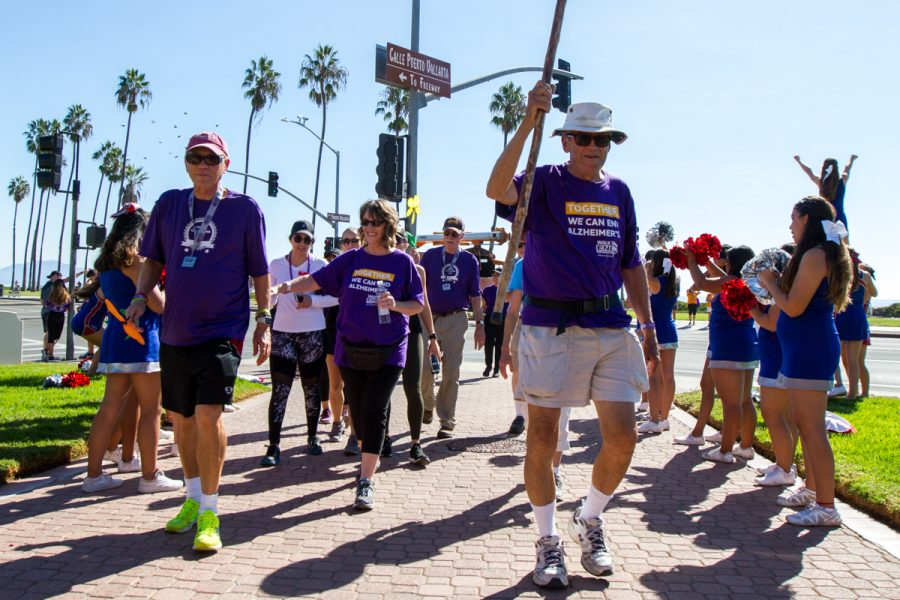 San Marcos High cheers on the participants as they make their way back to the Hilton during the annual Walk to end Alzheimer's on Saturday, Nov. 3, in Santa Barbara, Calif.