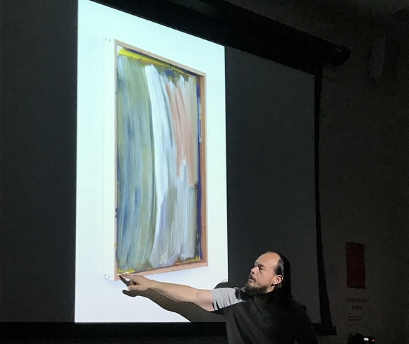 Greg Kozaki explains the details in one of his abstract pieces.  Kozaki is a  City College art instructor in addition to being abstract artist.