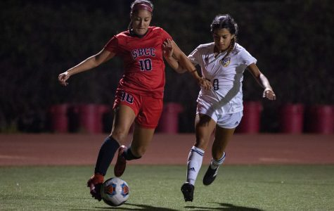 Lady Vaqueros Lourdes Marin-Rodriguez (No. 10) drives the ball through the Mesa's defense during the first playoff game on Saturday Nov. 17, at La Playa Stadium at City College, Santa Barbara, Calif. City College went on to win, 3-1.