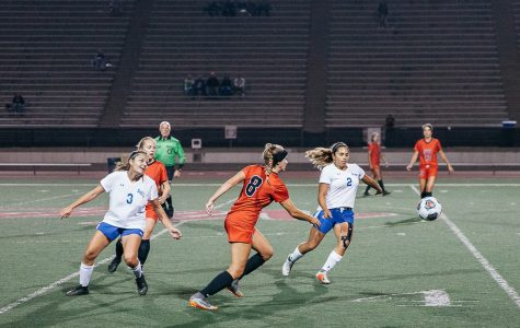 Lady Vaqueros defense Nicole Van Sickle (No. 8) races Allan Hancock midfielders Sienna Ramirez (No. 3) and Tatiana Silva (No. 2) for control of the ball on Tuesday, Nov. 6, at La Playa Stadium at City College in Santa Barbara, Calif. Van Sickle scored the second goal of the game during the first half.