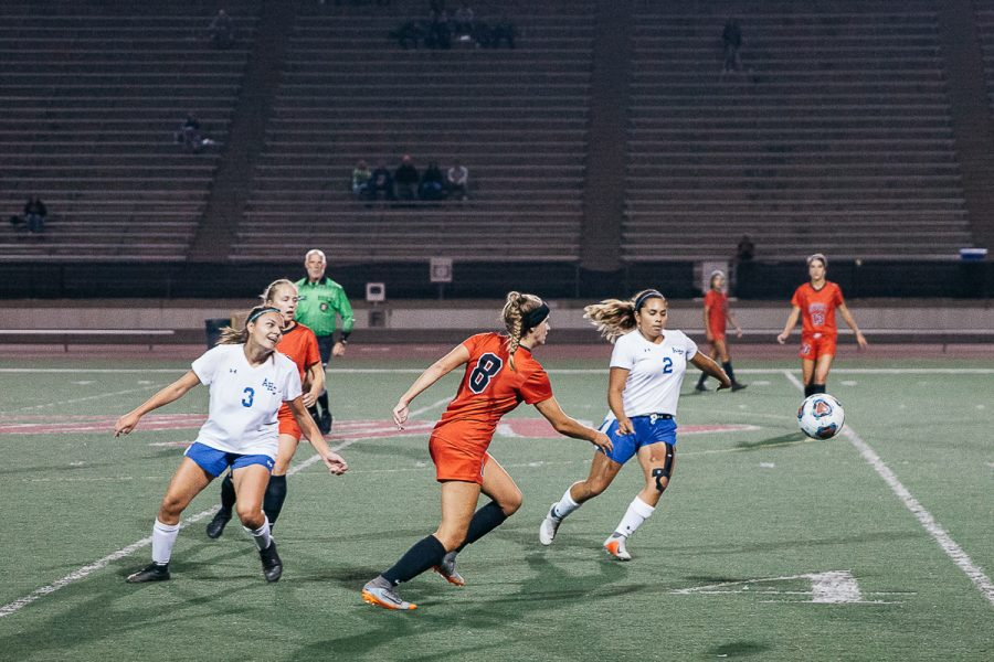 Lady+Vaqueros+defense+Nicole+Van+Sickle+%28No.+8%29+races+Allan+Hancock+midfielders+Sienna+Ramirez+%28No.+3%29+and+Tatiana+Silva+%28No.+2%29+for+control+of+the+ball+on+Tuesday%2C+Nov.+6%2C+at+La+Playa+Stadium+at+City+College+in+Santa+Barbara%2C+Calif.+Van+Sickle+scored+the+second+goal+of+the+game+during+the+first+half.