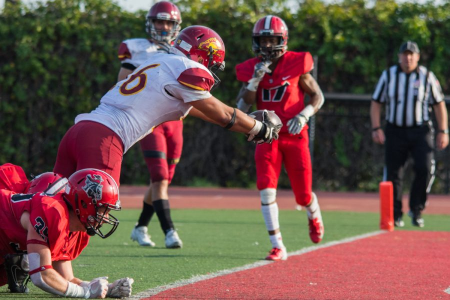 Chase Elliott (No. 35) and the rest of the Vaqueros defense fail to stop the Lancer, Salman Gurung (No. 26), in a two-point conversion giving them the lead Saturday afternoon on Nov. 10, 2018, at La Playa Stadium in Santa Barbara, Calif. City College were given a two yard penalty for having too many men on the field, giving Pasadena City College better field position to convert the two-point conversion, which resulted in the difference of the game.