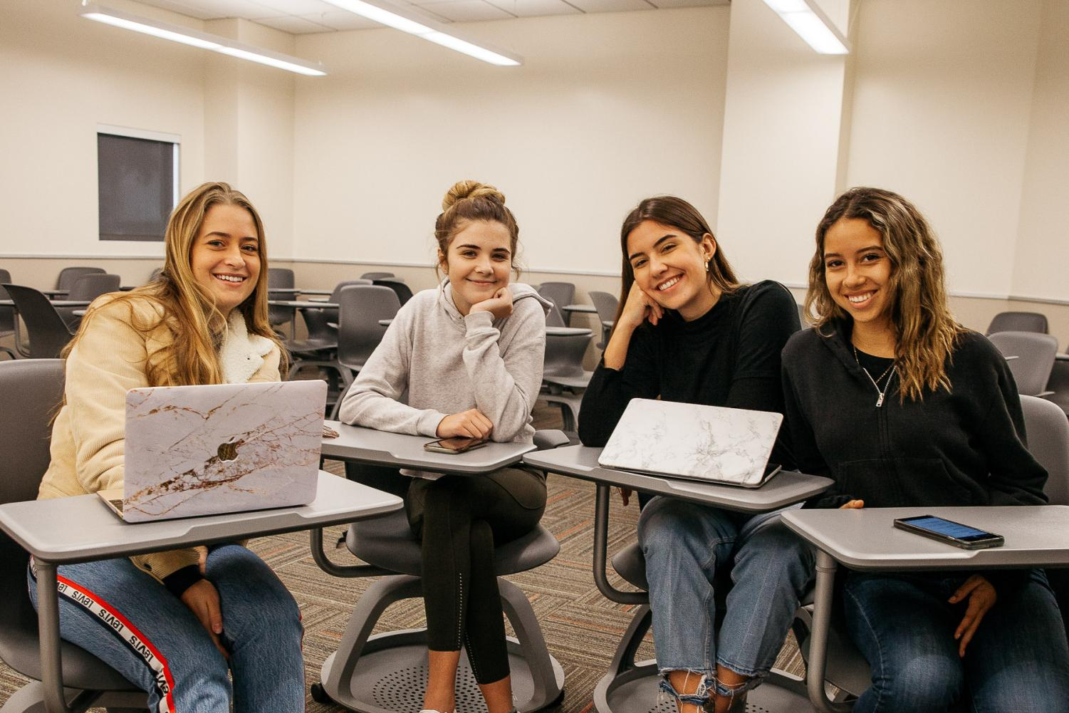 From left, Social Media Club Board Members Florentina Lang, Olivia Clark, Gabriela Donatti, and Jasmine Brewster pose on Tuesday, Dec. 6, in the West Campus Center at City College in Santa Barbara, Calif. The club intends to teach students about using social media as a marketing tool.