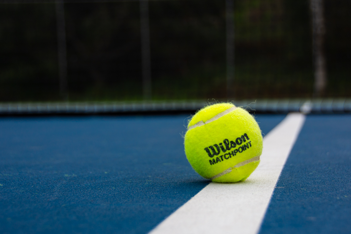 A Wilson ball lies at the sideline of a tennis court on Tuesday, Dec. 4, at Pershing Park in Santa Barbara, Calif. The Vaqueros welcome back coach Kelly Klein as she enters her second year as head coach for the Lady Vaqueros.