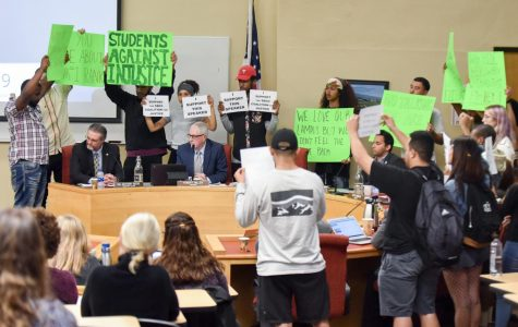 Racial tension, emotions erupt as protesters flood trustees' space