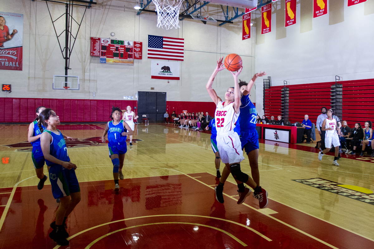 City College guard Jennae Mayberry (No. 22) goes for the jump shot against Oxnard College on Wednesday, Feb. 7 inside the Santa Barbara City College Sports Pavilion Gym. The Vaqueros defeated Oxnard College 74-61.