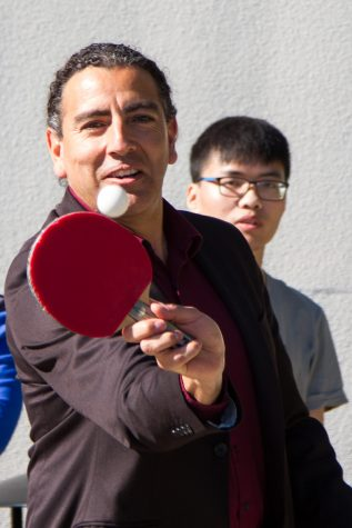 Arturo Rodriguez, dean of student affairs at City College, hits the ball during a game of table tennis the Ping Pong Club hosted outside the main campus cafeteria on Thursday, Feb. 7, 2019, at City College in Santa Barbara, Calif. Rodriguez will be donating a ping pong table to the club.