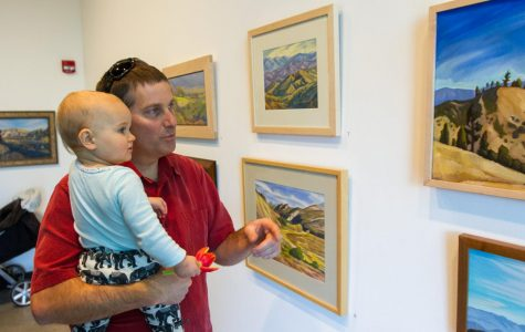 Matt Kay and his son Wren Kay look at artwork displayed during the Oak Group's exhibition 'In Wildness' on Jan. 25, 2018, at City College's Atkinson Gallery in Santa Barbara, Calif. The gallery featured landscape paintings by members of the Oak Group.
