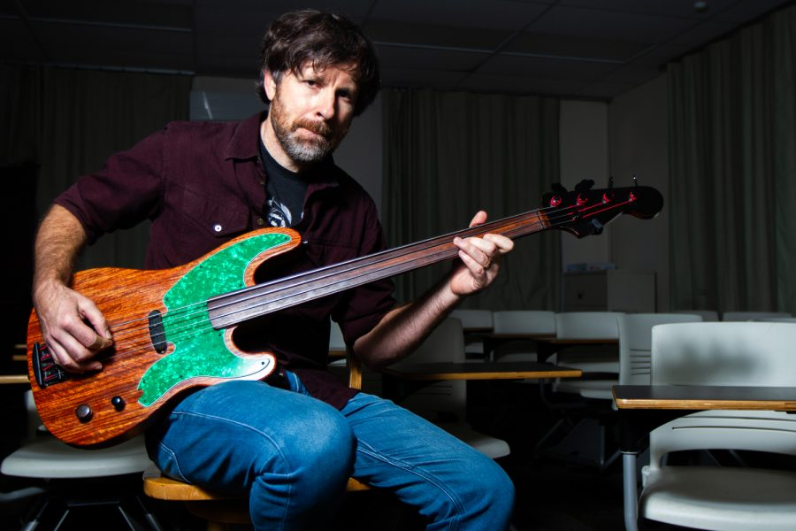Philosophy Professor Marc Bobro plays his custom bass in the Interdisciplinary Center Building on Friday, March 8, 2019, at City College in Santa Barbara, Calif. Bobro is the bassist in the band Crying 4 Kafka and has been playing bass for about 40 years.