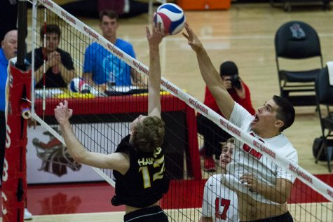 Vaquero middle blocker Cameron Clouse (No. 12) spikes the ball against Santiago Canyon on Friday, March 15, 2019, inside the Sports Pavilion at City College in Santa Barbara, Calif.