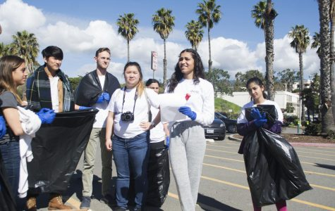 Layla Tondravi, a member of the leadership group of SBCC's Phi Kappa Theta Honors Society, speaks to a group of students gathered to participate in a beach clean up event March 9, 2019, at Leadbetter Beach Park in Santa Barbara, Calif.