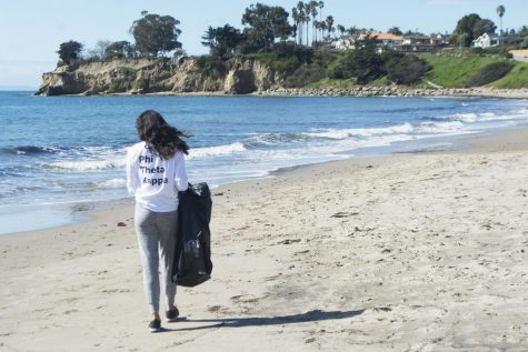 Phi Theta Kappa Vice President of Service Layla Tondravi walks the beach looking for trash during their beach clean up event on March 9, 2019 at Leadbetter Beach in Santa Barbara, Calif.