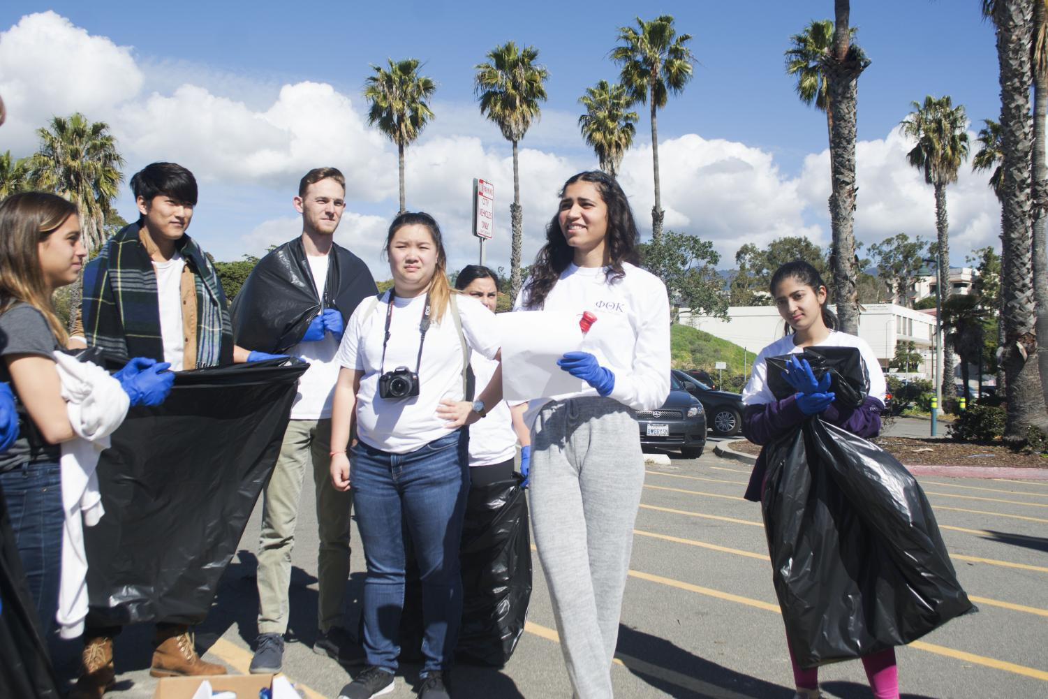 Layla Tondravi, a member of the leadership group of SBCC's Phi Kappa Theta Honors Society, speaks to a group of students gathered to participate in a beach clean up event Saturday, March 9, 2019, at Leadbetter Beach Park in Santa Barbara, Calif.
