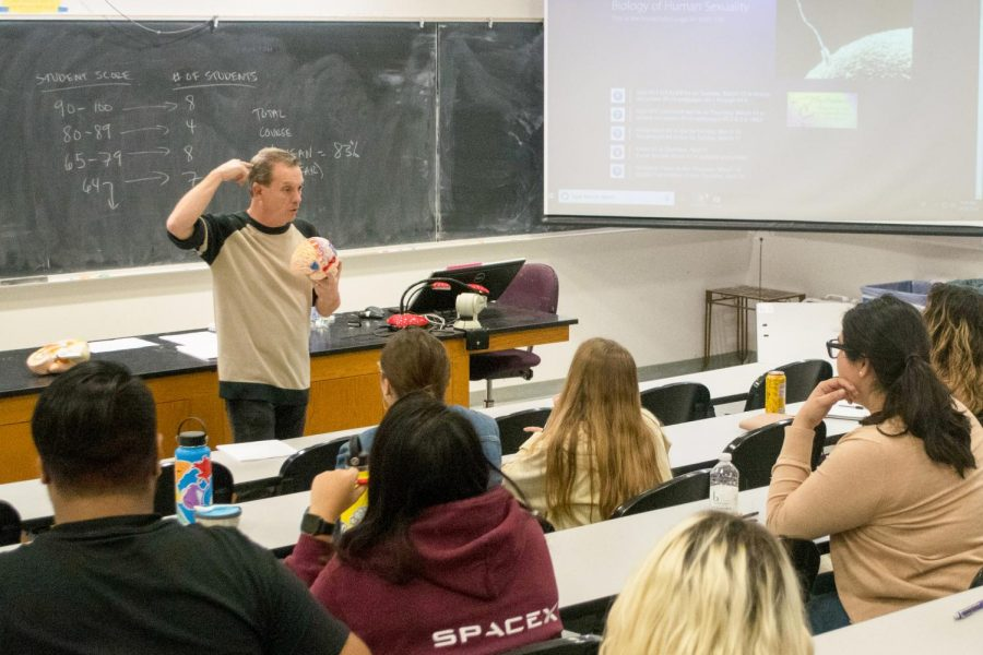 Blake Barron describes teaches students about the brain in his Biology of Human Sexuality class in the Earth and Biological Sciences Building Room 301 on Thursday, March 14, 2019 at City College in Santa Barbara, Calif.