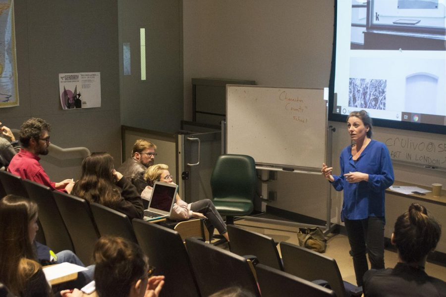 Mirjam Wendt explains to the audience her job as an art curator in museums and exhibits in the Humanities Building Room 111 on Thursday, March 7, 2019 at City College in Santa Barbara, Calif.