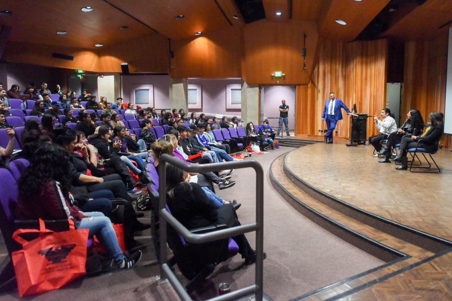 On the stage from left, Elias Serna, Lysa Flores and Sandra De La Losa answer questions from the audience during the Xicanx Culture Conference on Saturday, March 16, 2019, in the Business and Communication Forum at City College in Santa Barbara, Calif.