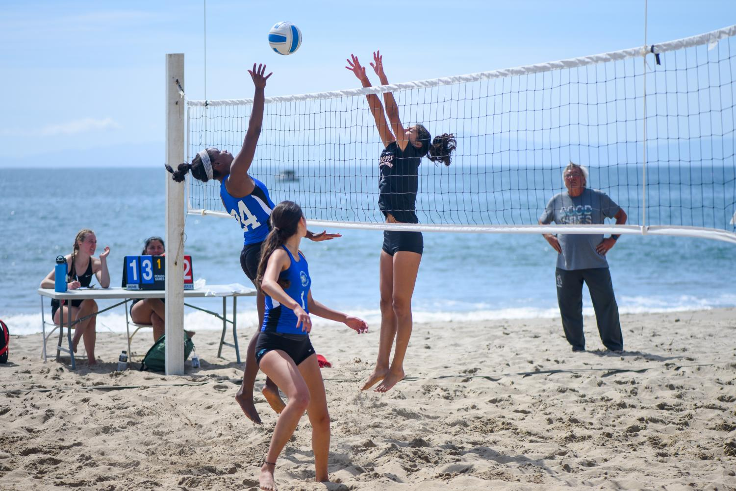 Brianna Montgomery (No. 24) hits the ball to Jacque Oregon (No.7) on Friday, March 22, 2019, at East Beach in Santa Barbara, Calif. The Vaqueros lost this set 21-5.