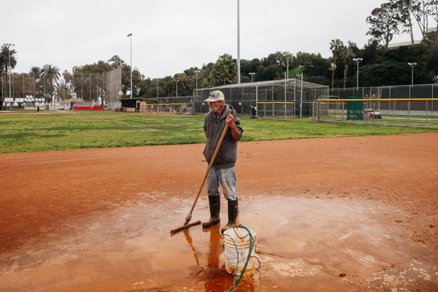 "Bruce Falen takes a brief pause from dispersing water gathered in puddles from recent rains on Thursday, Feb. 28, 2019 on the Pershing Park City College softball fields in Santa Barbara, Calif. ""I have been here since 9 a.m. and I still have a lot more to do,"" said Falen. ""It just doesn't drain enough here, especially when there is no wind."""