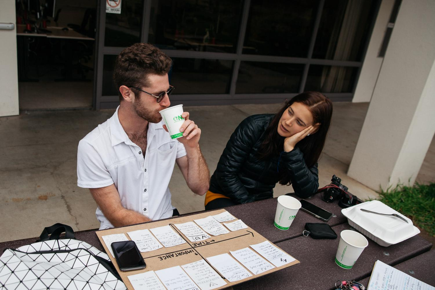 Adam Verhasselt and Gaia Menni discuss future goals and ideas over coffee during the Creative Club meeting on Friday, March 1, 2019 in front of the Occupational Education building at City College in Santa Barbara, Calif. The club meets every Friday at noon.