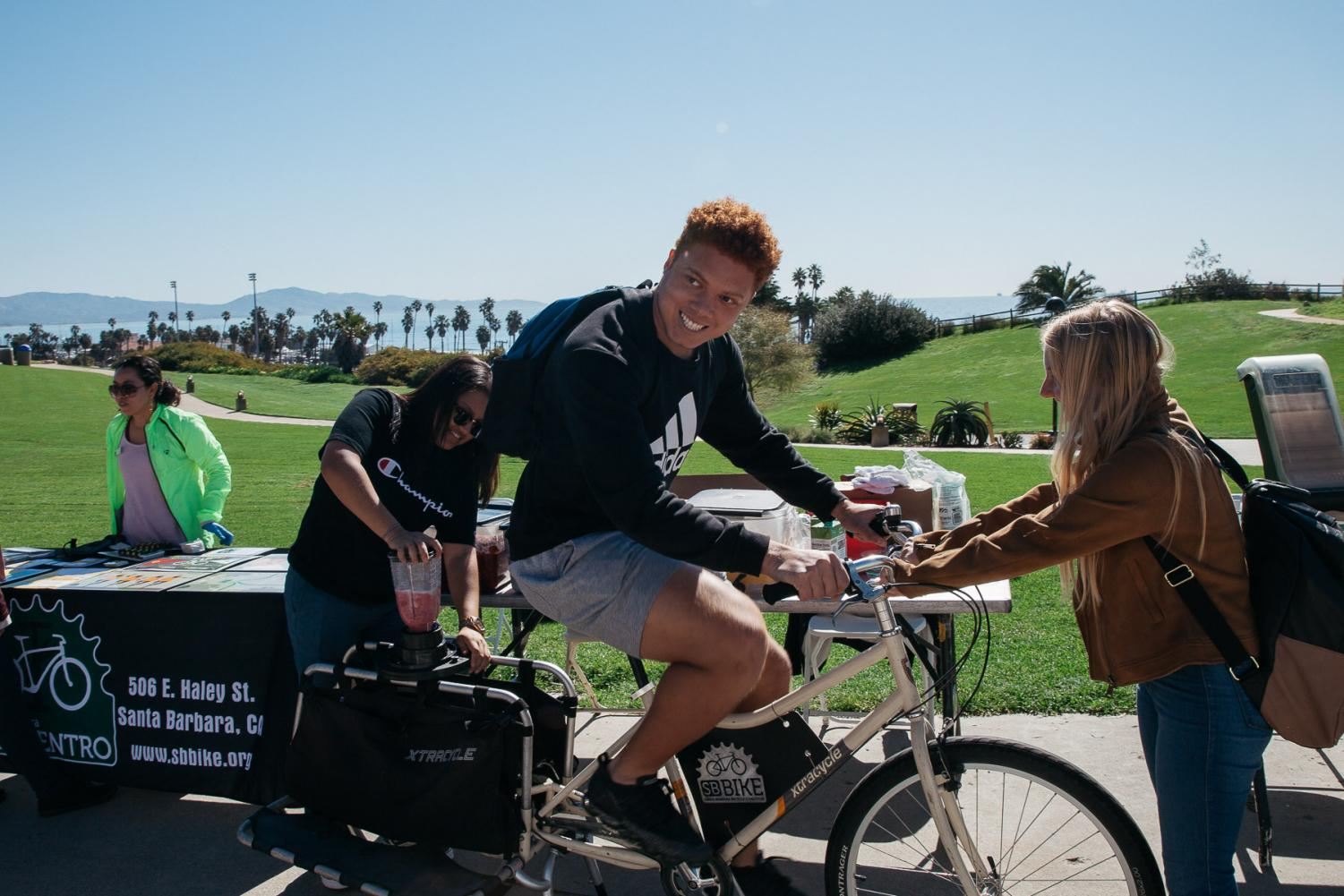 Isaac Brown pedals a blender bike to make an energy efficient smoothie during sustainability day on Thursday, March 14, 2019 on West Campus at City College in Santa Barbara, Calif. The bike, provided by Bici Centro, uses the power from pedaling to spin the blender blades and make free smoothies for students to encourage biking to burn less fossil fuels.