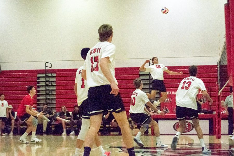 Outside hitter Trent Lingruen, (No.15), jumps to attack a set during the second game of the Vaquero's match against Orange Coast on March 16, 2019 in the Sports Pavillion Gym at City College in Santa Barbara, Calif. The Vaqueros lost the match in 5 sets.