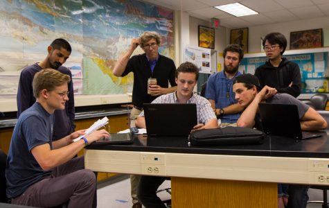 From left, Bryce Mather, Joneel Zinto, Bill Dinklage, Weston Ferrell, Zachary Gundrey, Brandon Reedel, and Craig Xie discuss plans for setting up a solar powered phone charging table by the cafeteria patio. The table would include five or six cords only for phones, since it requires less power.