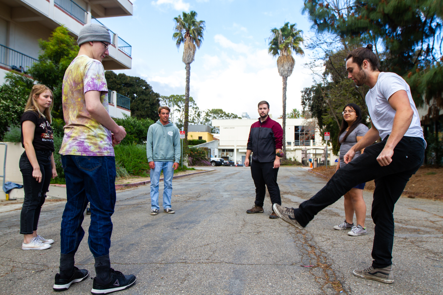 President of the Hacky Sack Club Ben Early, right, kicks the footbag while the other members, from left, Alex Sasich, Elijah Akia, Dylan Rief, Taji Tanner, and Rocio Reyes get ready for the ball to be passed around outside the Earth and Biological Sciences Building on Thursday, March 21, 2019, at City College in Santa Barbara, Calif. The Hacky Sack Club meets 4 p.m. on Thursdays.