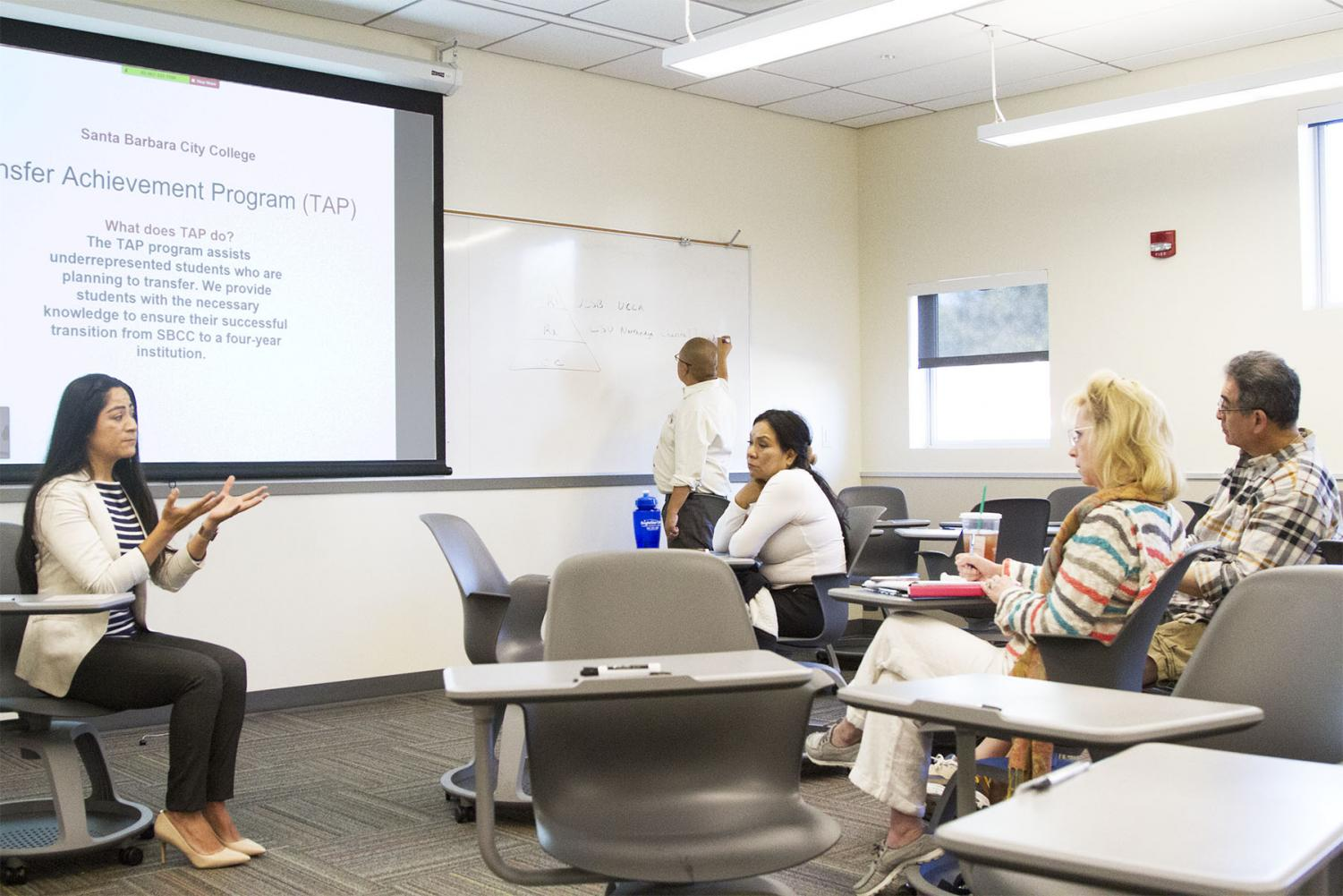 Jenny Erika Barco talks to possible future City College night students about the amenities the program will offer on Saturday, April 6, 2019 in the West Campus Center Room 121 at City College in Santa Barbara, Calif.