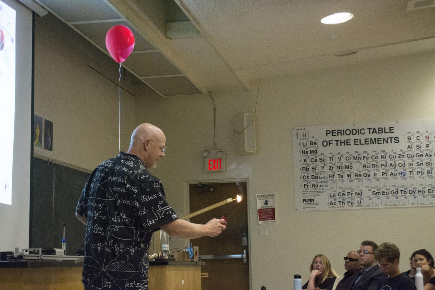 Doctor Michael Young demonstrates how a Hydrogen bomb works with a balloon and how the chemical reacts to heat in the Futurism Club on Thursday, April 18, 2019, in the Physical Sciences Building Room 101 at City College in Santa Barbara, Calif.