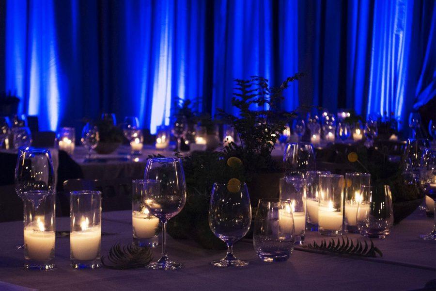 Tables are set up with candles, plants, and glasses in preparation for the Inaugural SBCC Foundation's Fundraising Gala Event in the Sports Pavilion Gym at 6pm on Saturday, April 27, 2019, on City College in Santa Barbara, Calif.