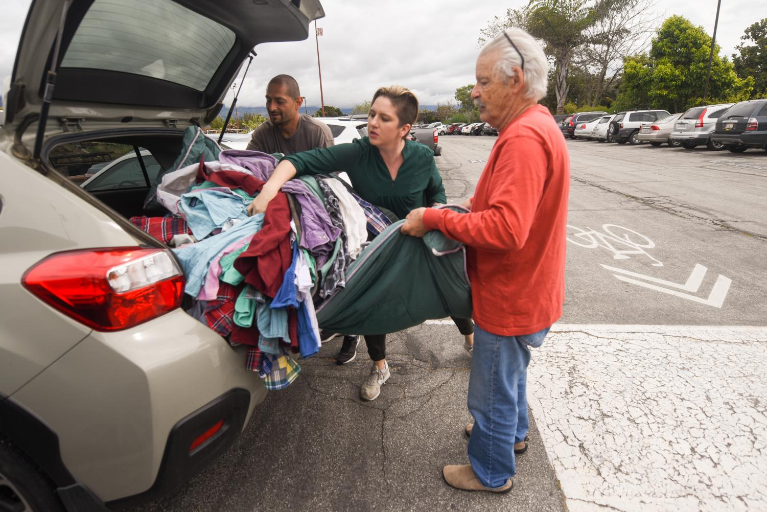 From left, Rafael Castro and Raeanne Napoleon help Larry Friesen unload his donation of 110 shirts to Tiffany's Closet on Friday, April 5, 2019, in front of the donation drop off Room ECC 6 at City College in Santa Barbara, Calif. Castro stepped in to help unload the shirts and Napoleon organized the donations.