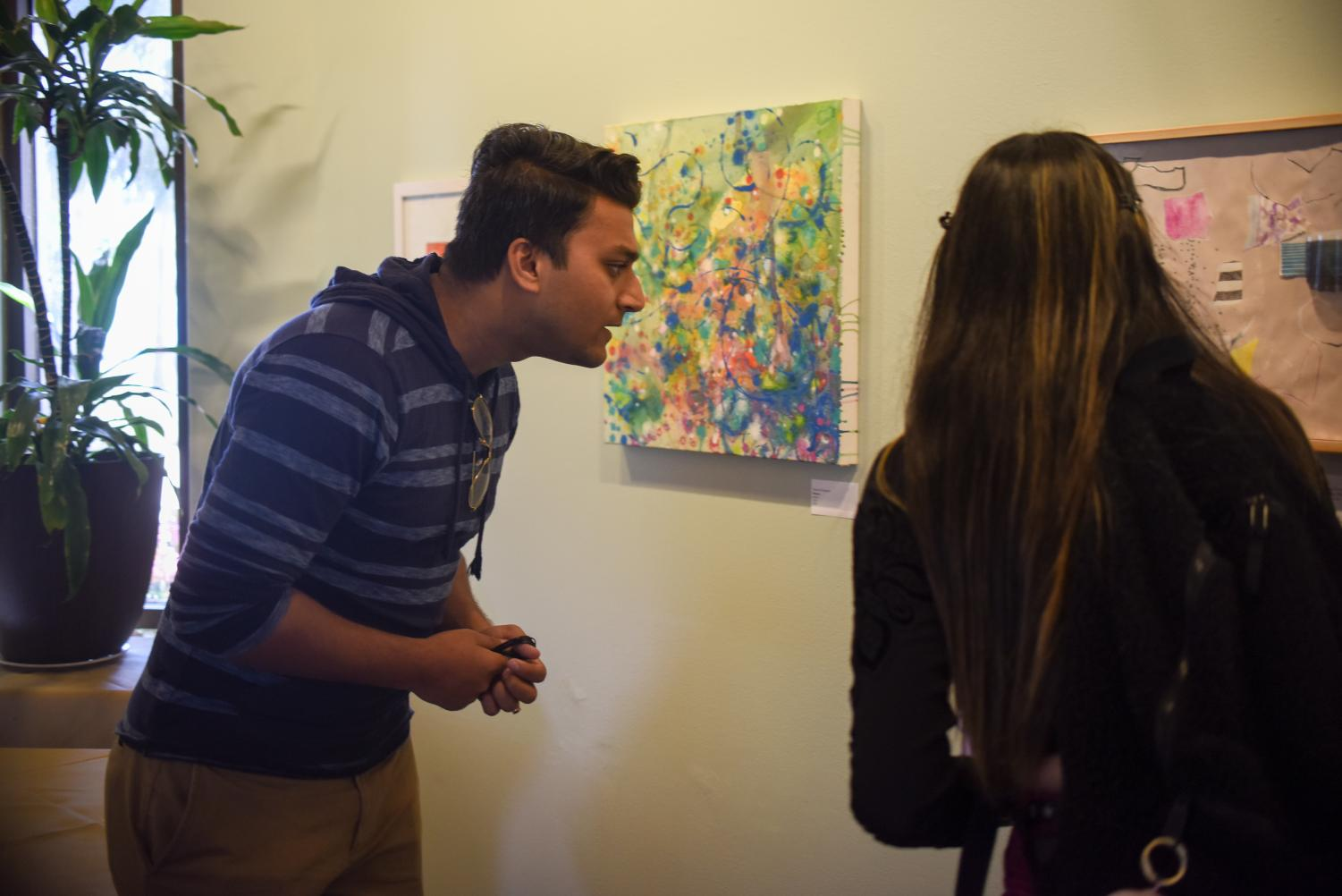 Romit Mukherjee looks at the Non-Objective Art exhibit on Tuesday, April 2, 2019, in the John Dunn dining hall at City College in Santa Barbara, Calif.
