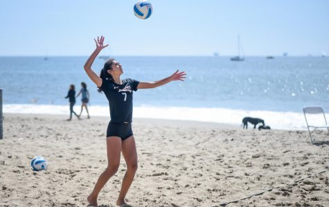 Jacque Ortegon serves the ball at a beach volleyball game on March 21, 2019, at East Beach in Santa Barbara, Calif.