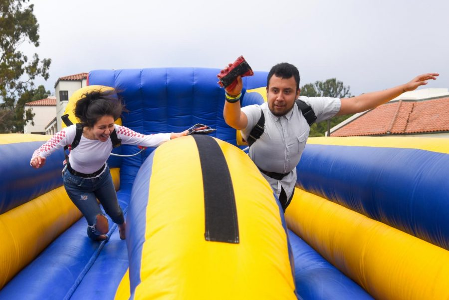 Samantha Cazares and Carlos Barrayo race to stick their bean bag farthest at the Spring Festival on April 24, 2019, on the West Campus Lawn at City College in Santa Barbara, Calif.