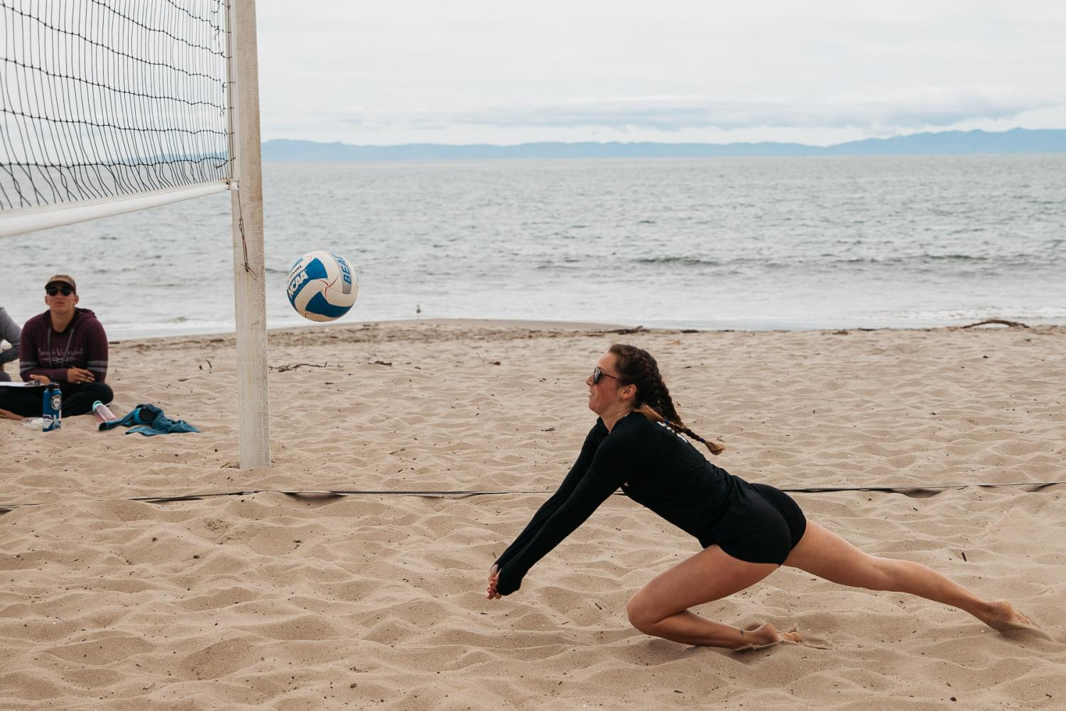 Emma Esparza dives for the ball on Friday, April 5, 2019, at East Beach in Santa Barbara, Calif.