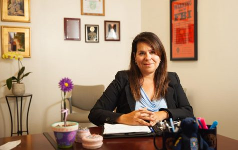 """Former FBI agent Linda Esparza Dozer sits in her office as the new Title IX, gender equity coordinator on Friday, April 19, 2019, in the Administration Building at City College in Santa Barbara, Calif. """"I want students to know my door is open, they can walk in, they can email me, they can call me to ask questions about sexual respect or to learn how to become an FBI agent."""" Said Dozer."""