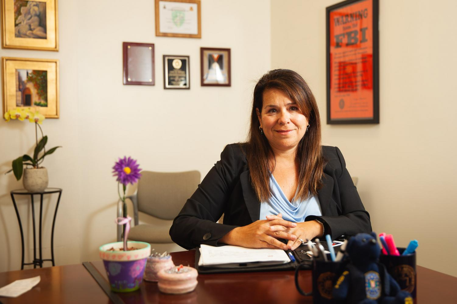 "Former FBI agent Linda Esparza Dozer sits in her office as the new Title IX, gender equity coordinator on Friday, April 19, 2019, in the Administration Building at City College in Santa Barbara, Calif. ""I want students to know my door is open, they can walk in, they can email me, they can call me to ask questions about sexual respect or to learn how to become an FBI agent,"