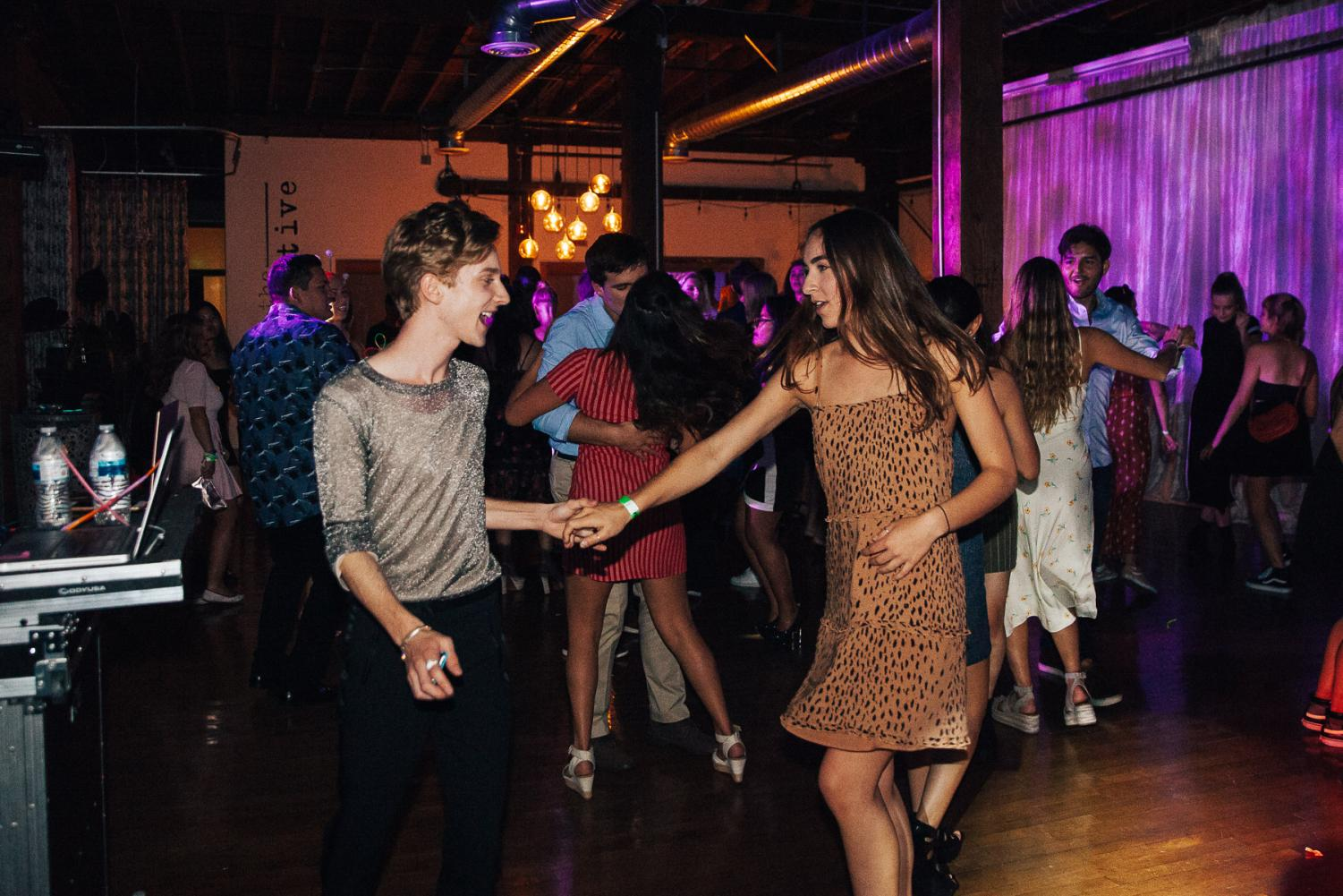 Sunny De'Vries Paulson dances and laughs with Haley Kittleson during the American Prom for International Students on Thursday, April 25, 2019, at The Narrative Loft in Santa Barbara, Calif.