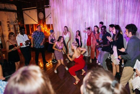 Alice Bessou, in red, and Stella Sepassipour dance in the middle of a dance circle during the American Prom for International Students on Thursday, April 25, 2019, at The Narrative Loft in Santa Barbara, Calif. The dance intended to introduce international student to the American prom experience.