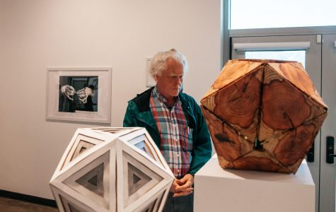 Karl Blasius observes a sculpture during the Annual Student Exhibition on Friday, April 12, 2019, in the Atkinson Gallery at City College in Santa Barbara, Calif. Blasius, a phycology major at SBCC, used to be an art major and once had his work featured in the Atkinson Gallery 12 years back.