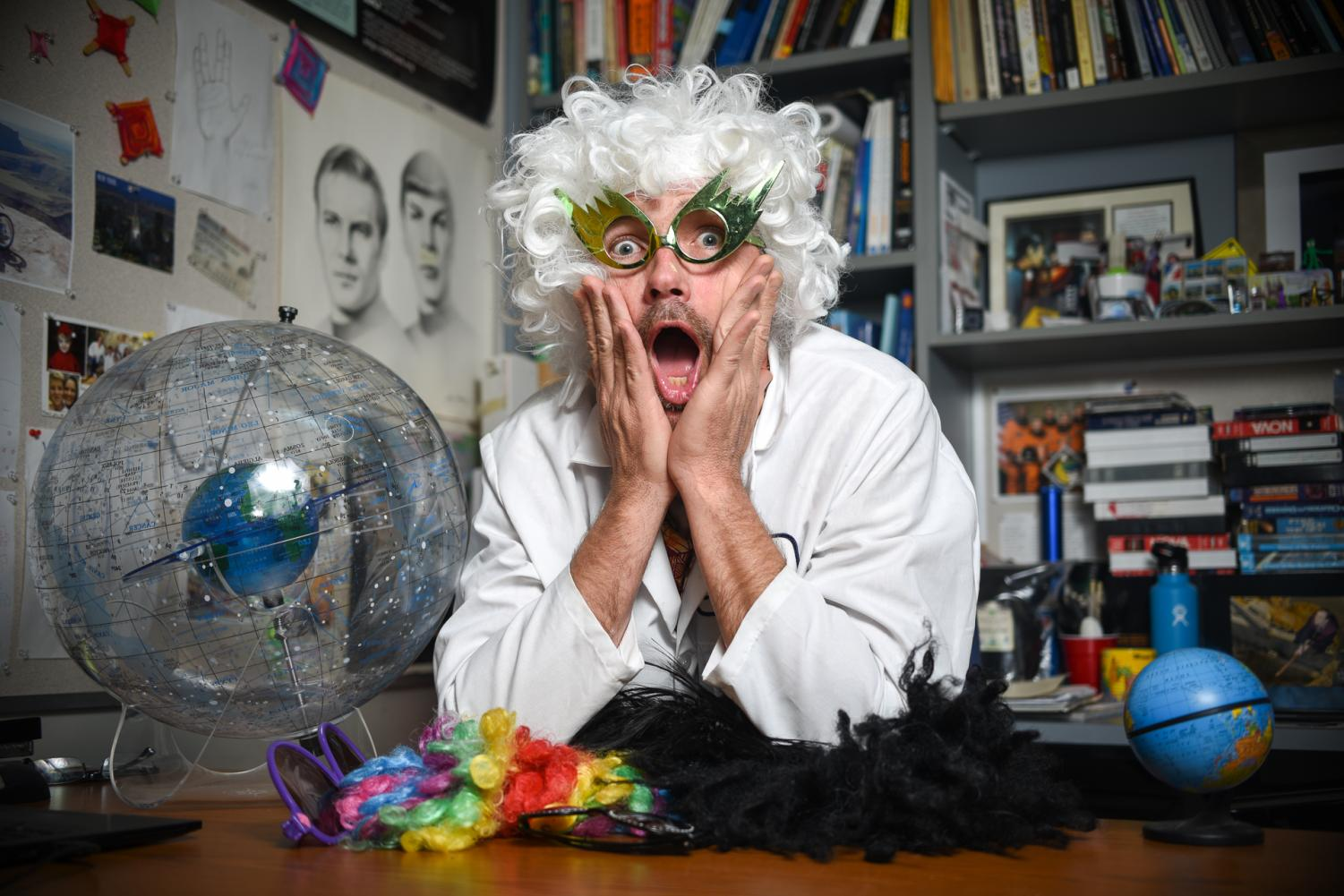 "Erin O'Connor shows off his ""alternative learning"" techniques in his office on April 29, 2019, at City College in Santa Barbra, Calif. He said he uses his collection of wigs and funky glasses to engage and teach students."