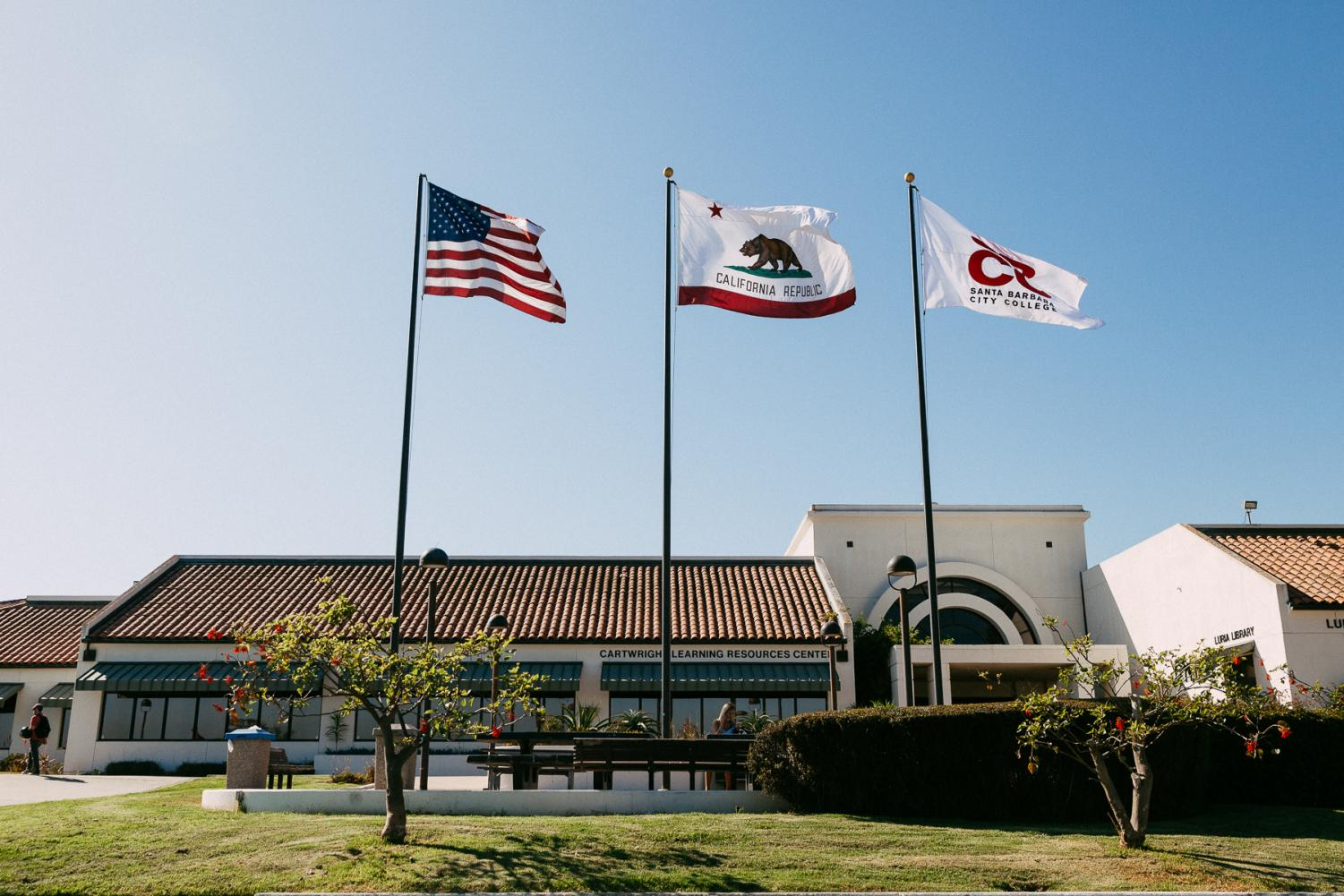 Flags dance in the afternoon breeze in front of the Cartwright Learning Resources Center on Thursday, Aug. 29, 2019, on West Campus in Santa Barbara, Calif.