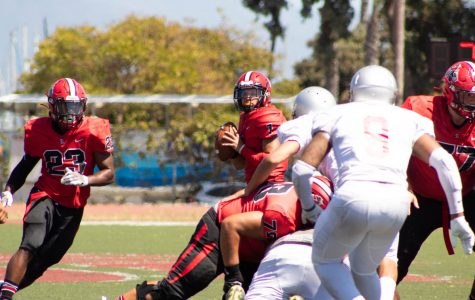 Vaqueros Quaterback Scotty Forbes looks down field for an open pass to Trey Hunter (No.23) on Friday, Sept. 7 at La Playa Stadium at City College in Santa Barbara, Calif. The Vaqueros went on to beat the Tartars 57-6.