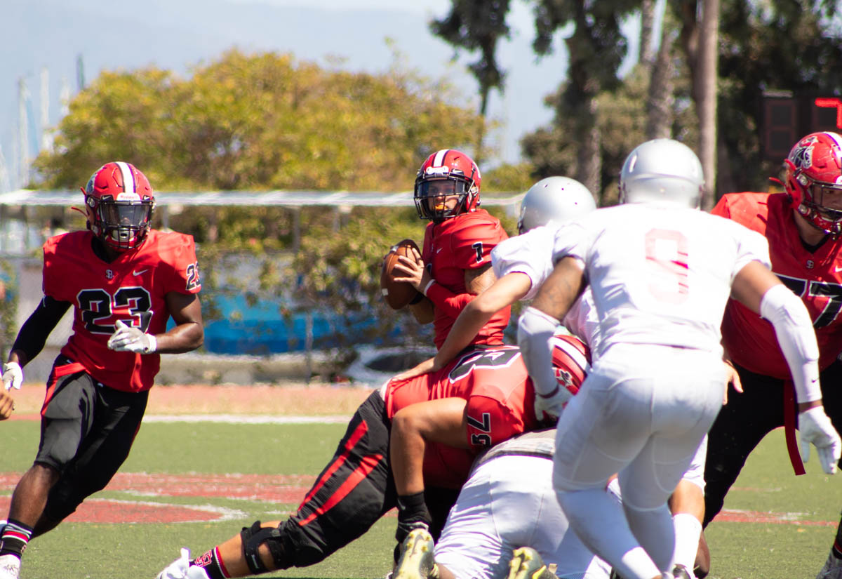 Vaqueros Quarterback Scotty Forbes looks down field for an open pass to Trey Hunter (No.23) on Friday, Sept. 7 at La Playa Stadium at City College in Santa Barbara, Calif. The Vaqueros went on to beat the Tartars 57-6.
