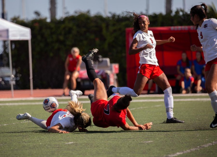 Makaylla White (No.7) takes a tumble in pursuit of the ball on Tuesday afternoon, Sept. 17, 2019, at La Playa Stadium at City College in Santa Barbara, Calif.