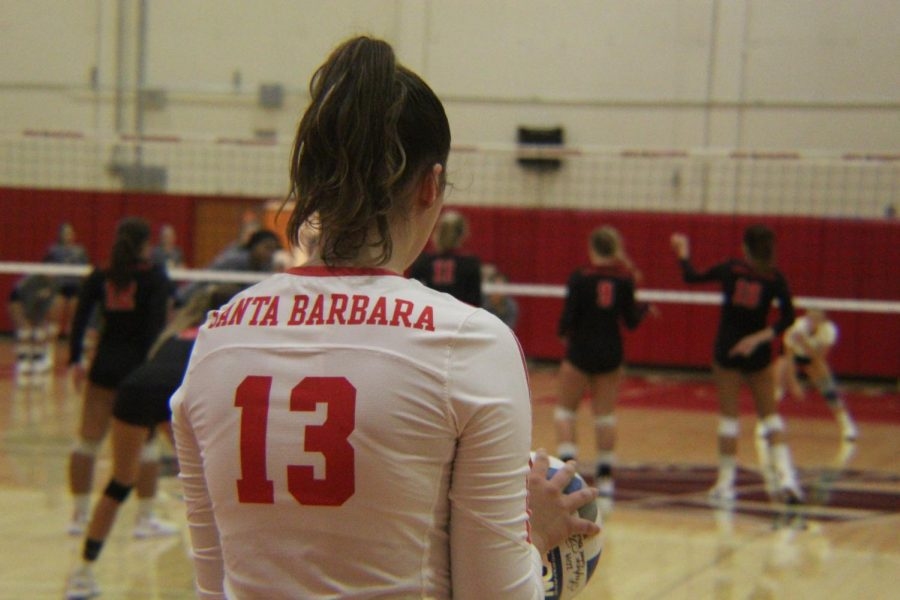 Bella Brandt stands in position to serve the ball during a match against the Canyons on Wednesday, Sept. 11 2019, in the Sports Pavilion at City College in Santa Barbara, Calif. The Vaqueros beat the Canyons 3-1.