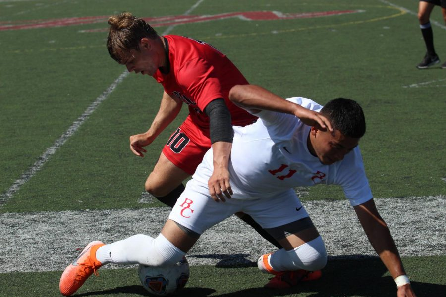 Christopher Robinson in red, forces the ball away from Omar Reyes-Madrid on Friday, Sept. 13 2019, on La Playa Field at City College in Santa Barbara, Calif. The Vaqueros beat Bakersfield 3-1.