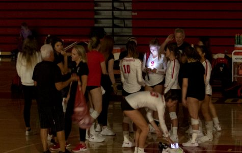 Vaquero volleyball players huddle around and wait for information about the power outage on Friday, Sept. 20, 2019, in theSports Pavilion at City College in Santa Barbara, Calif. The game was eventually canceled.