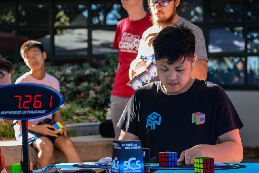 Current SpeedCubing Champion Max Park stops the timer after solving his 3x3 Rubik's Cube on Saturday, Sept. 28, 2019, on west campus at City College in Santa Barbara, Calif. Park won three of the events with the fastest solving time during the competition.